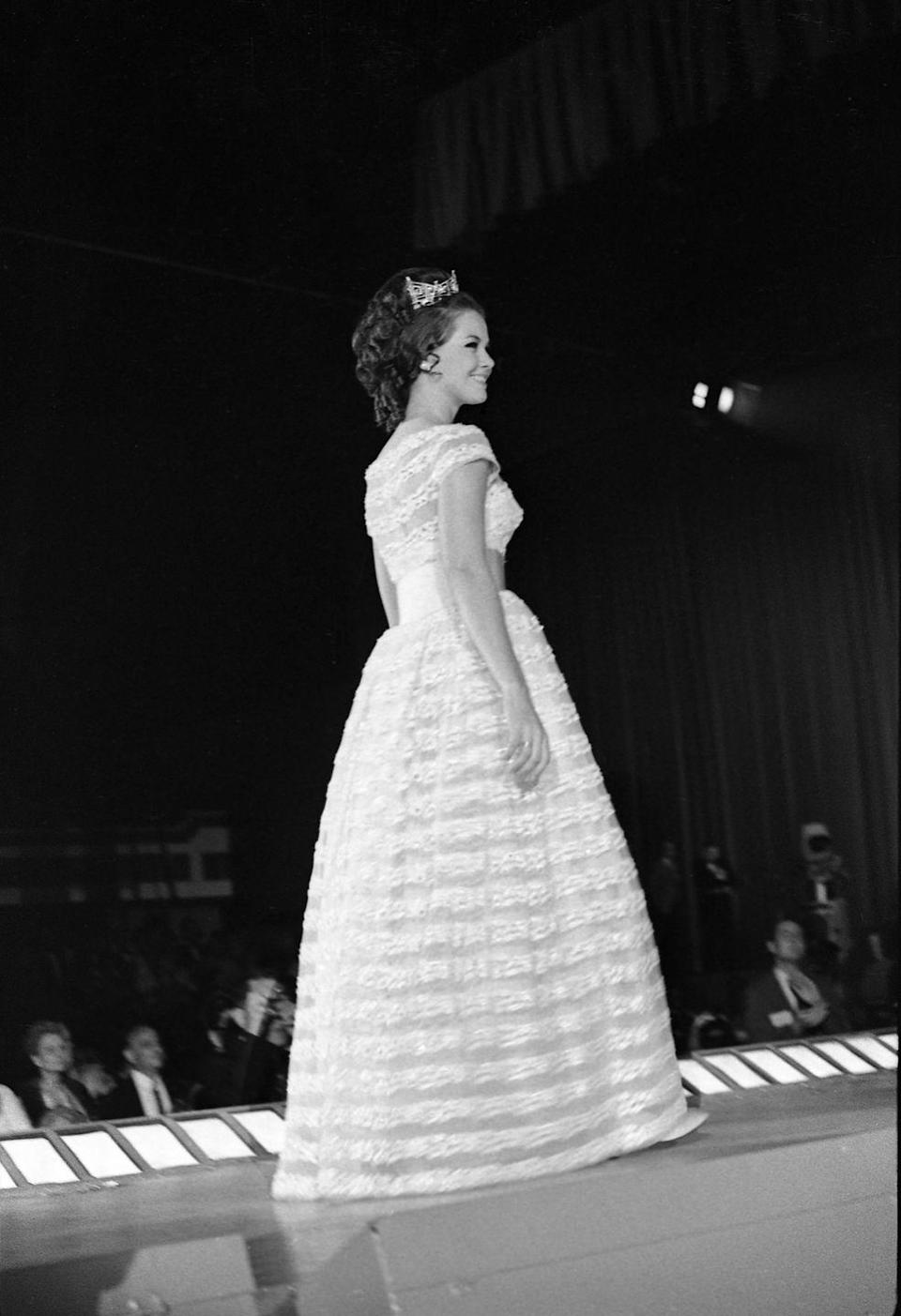 <p>Moving into the late '60s, winner Debra Barnes made an impression on the runway in this short-sleeve lacy dress in 1968. </p>
