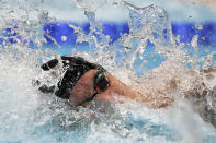 Caeleb Dressel of the United States swims in the men's 100-meter freestyle final at the 2020 Summer Olympics, Thursday, July 29, 2021, in Tokyo, Japan. (AP Photo/Matthias Schrader)