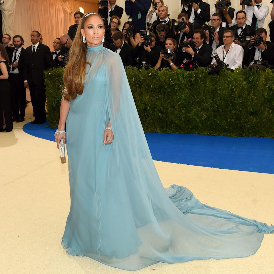 <p>When Jennifer Lopez arrived at the 2017 Met Gala, she looked every inch like Princess Elsa—from her sheer cape dress by Valentino to her ice-like jewels by Harry Winston. </p>
