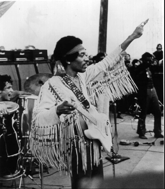 Jimi Hendrix played to an estimated audience of 200,000 people at the end of the inaugural Woodstock music festival in 1969.