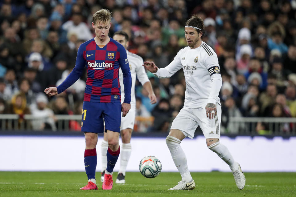 MADRID, SPAIN - MARCH 1: (L-R) Frenkie de Jong of FC Barcelona, Sergio Ramos of Real Madrid during the La Liga Santander  match between Real Madrid v FC Barcelona at the Santiago Bernabeu on March 1, 2020 in Madrid Spain (Photo by David S. Bustamante/Soccrates/Getty Images)