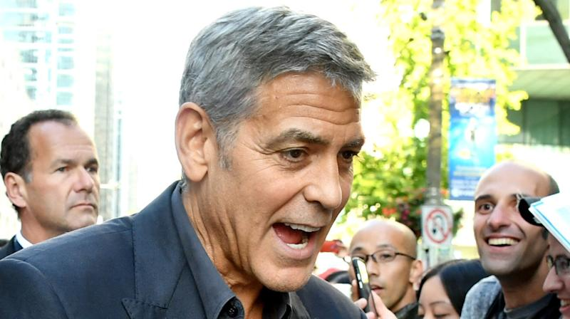 Reddit Can't Get Enough Of A Fan Caressing George Clooney's Face