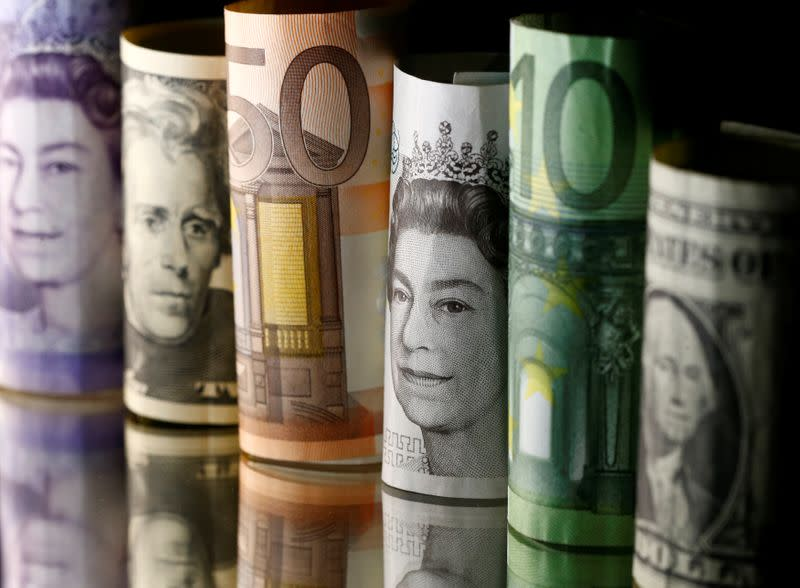 Dollar, Euro and Pound banknotes are seen in this picture illustration