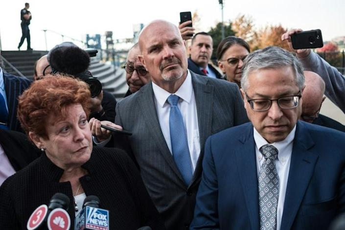 Ilene Shapiro (L), executive director of Summit County, Michael O'Malley (C), the Cuyahoga county prosecutor, and Mark Lanier, a lawyer representing Cuyahoga and Summit counties, brief the press in Cleveland, Ohio (AFP Photo/Megan JELINGER)