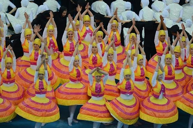 Dancers perform during the opening ceremony prior the kick off of the Euro 2012 football championships match Poland vs. Greece, on June 8, 2012 at the National Stadium in Warsaw. AFP PHOTO / JANEK SKARZYNSKIJANEK SKARZYNSKI/AFP/GettyImages