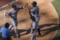 San Francisco Giants' Austin Slater, top left, celebrates with teammates Brandon Belt, top right, and Tommy La Stella, bottom right, after hitting a home run during the sixth inning of a baseball game against the San Diego Padres, Thursday, Sept. 23, 2021, in San Diego. (AP Photo/Gregory Bull)