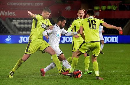 Soccer Football - FA Cup Fourth Round Replay - Swansea City vs Notts County - Liberty Stadium, Swansea, Britain - February 6, 2018 Swansea City's Wayne Routledge in action with Notts County's Shaun Brisley REUTERS/Rebecca Naden