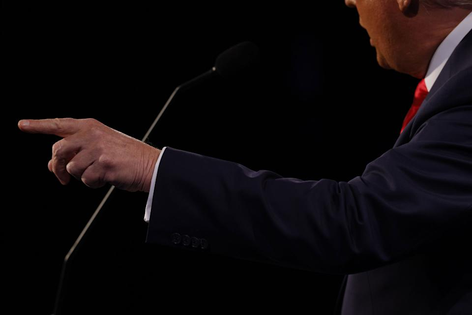 """President Donald Trump speaks during the final presidential debate.<span class=""""copyright"""">Jim Bourg—Pool/AFP/Getty Images</span>"""