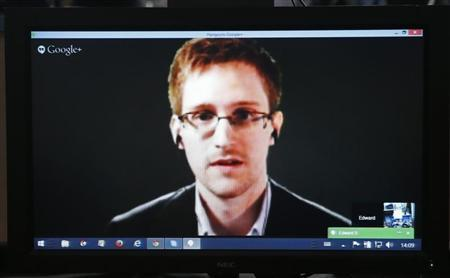 Accused government whistleblower Snowden is seen on a screen as he speaks via videoconference with members of the Committee on legal Affairs and Human Rights of the Parliamentary Assembly of the Council of Europe in Strasbourg