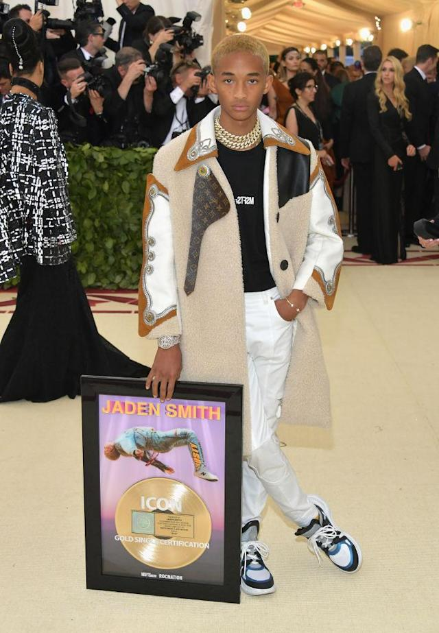 <p>Smith might be a guest of Louis Vuitton, but he didn't neglect to bring his latest record with him as a date. (Photo: Getty Images) </p>