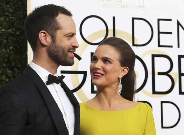 "The ""Black Swan"" actress is seen with her husband French dancer and choreographer Benjamin Millepied in January. (Mike Blake / Reuters)"