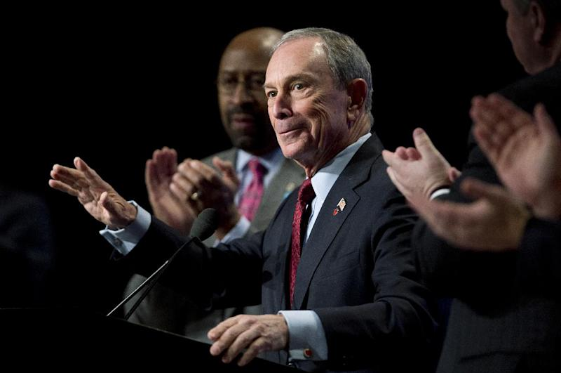 New York City Mayor Michael Bloomberg acknowledges applause during the U.S. Conference of Mayors 81st winter meeting in Washington, Friday, Jan. 18, 2013. At left is U.S. Conference of Mayors President. Philadelphia Mayor Michael Nutter (AP Photo/Manuel Balce Ceneta)
