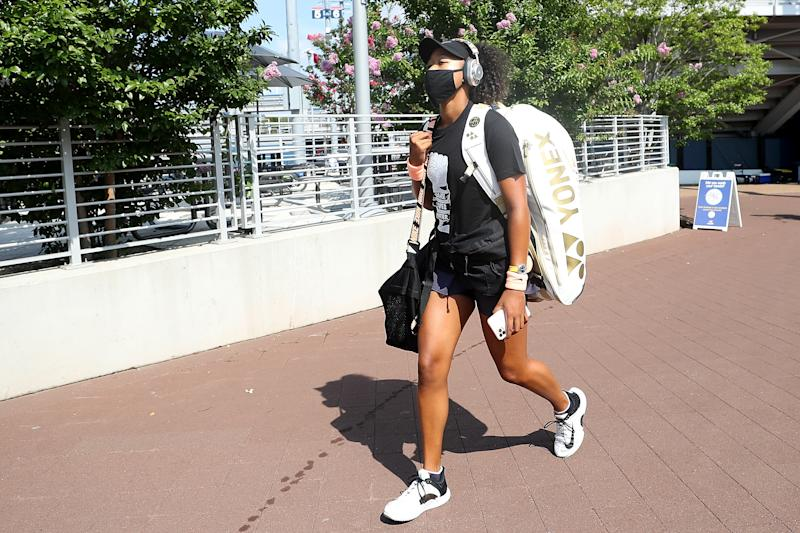 Naomi Osaka walks to her semifinals match at the Western & Southern Open.