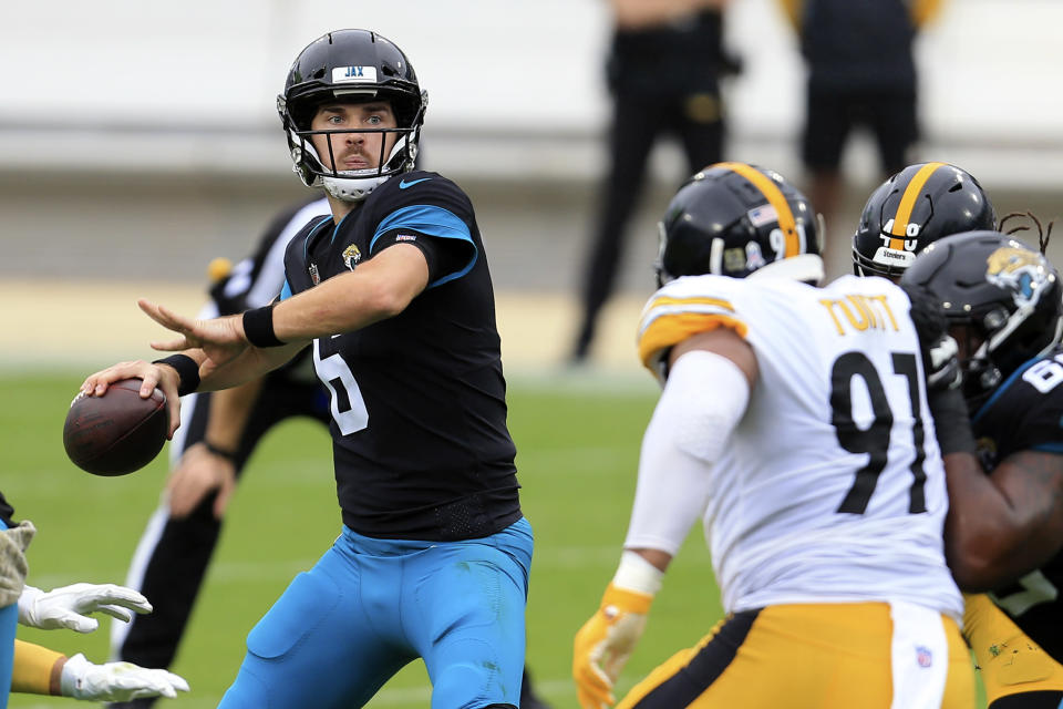 Jacksonville Jaguars quarterback Jake Luton, left, throws a pass as he is rushed by Pittsburgh Steelers defensive tackle Cameron Heyward (97) during the first half of an NFL football game, Sunday, Nov. 22, 2020, in Jacksonville, Fla. (AP Photo/Matt Stamey)