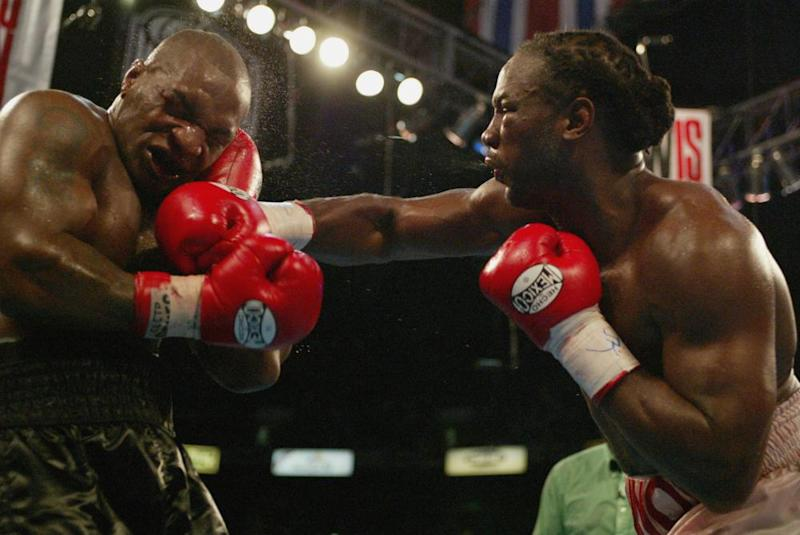 Lennox Lewis hits Mike Tyson with a right hook in the 8th round.