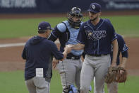 Tampa Bay Rays starting pitcher Ryan Thompson, right, hands the ball to manager Kevin Cash, left, as he is pulled during the second inning in Game 4 of a baseball American League Division Series against the New York Yankees, Thursday, Oct. 8, 2020, in San Diego. (AP Photo/Jae C. Hong)