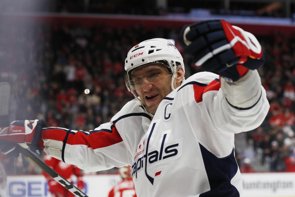 Washington Capitals left wing Alex Ovechkin celebrates the goal of right wing Tom Wilson during the third period of the team's NHL hockey game against the Detroit Red Wings, Saturday, Nov. 30, 2019, in Detroit. (AP Photo/Carlos Osorio)