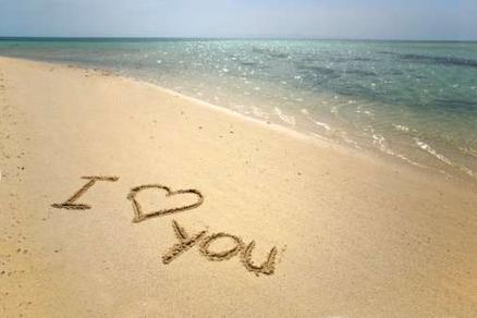Creative ways to tell someone you love them: Write it in the sand