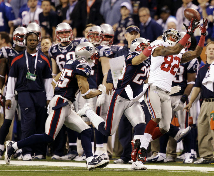 ADVANCE FOR WEEKEND EDITIONS, MARCH 10-11 - FILE - In this Feb. 5, 2012, file photo, New York Giants wide receiver Mario Manningham (82) catches a pass ahead of New England Patriots defensive back Sterling Moore, center, and safety Patrick Chung, left, during the second half of the NFL Super Bowl XLVI football game in Indianapolis. A week after a record 21 players were given franchise tags, the NFL's free agency free-for-all begins. As the the No. 3 receiver in the Meadowlands behind Hakeem Nicks and Victor Cruz, Manningham's contract situation is in a tenuous position despite his Super Bowl credentials. (AP Photo/Marcio Jose Sanchez, File)