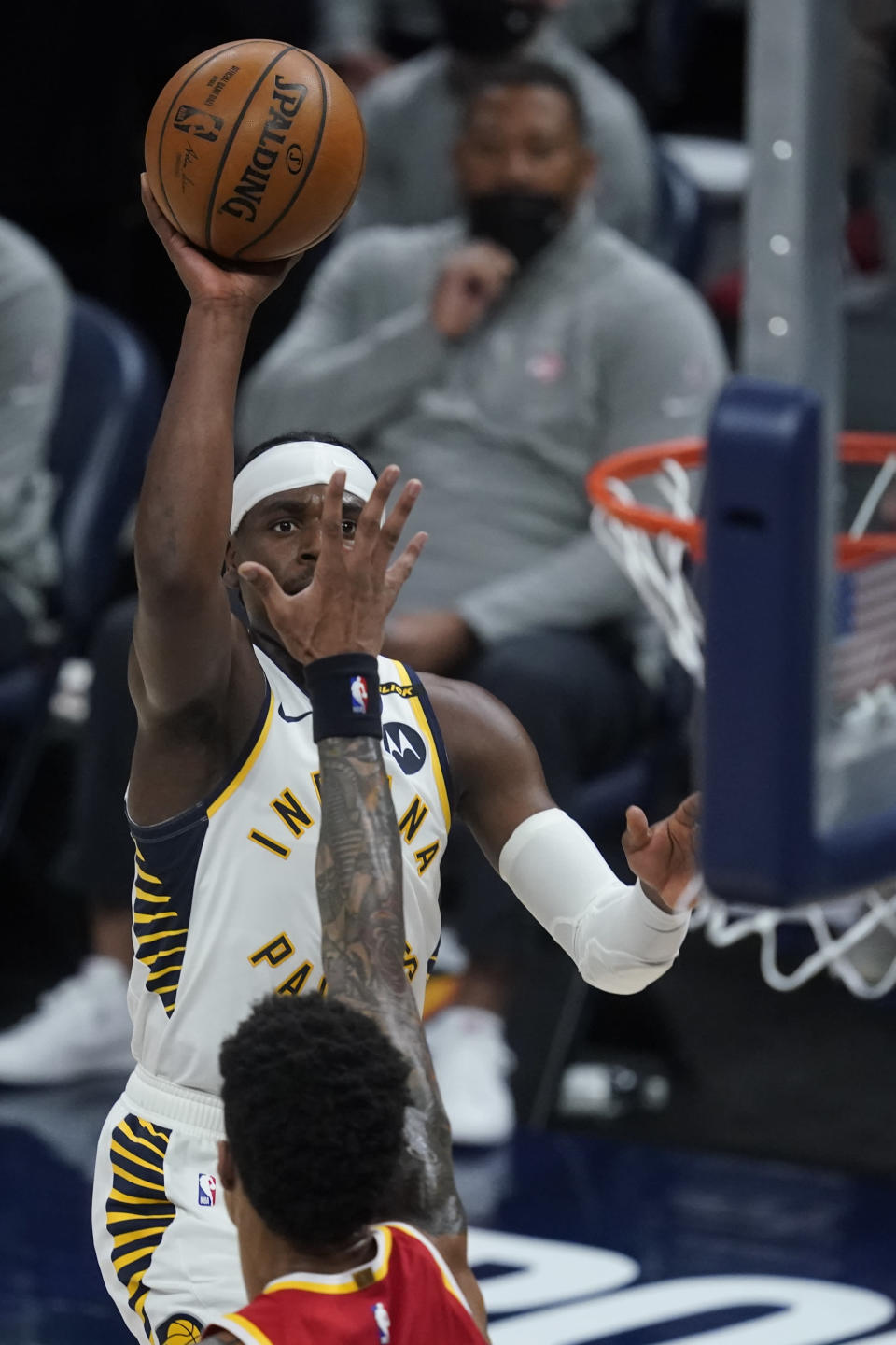 Indiana Pacers' Aaron Holiday shoots during the second half of the team's NBA basketball game against the Atlanta Hawks, Thursday, May 6, 2021, in Indianapolis. (AP Photo/Darron Cummings)