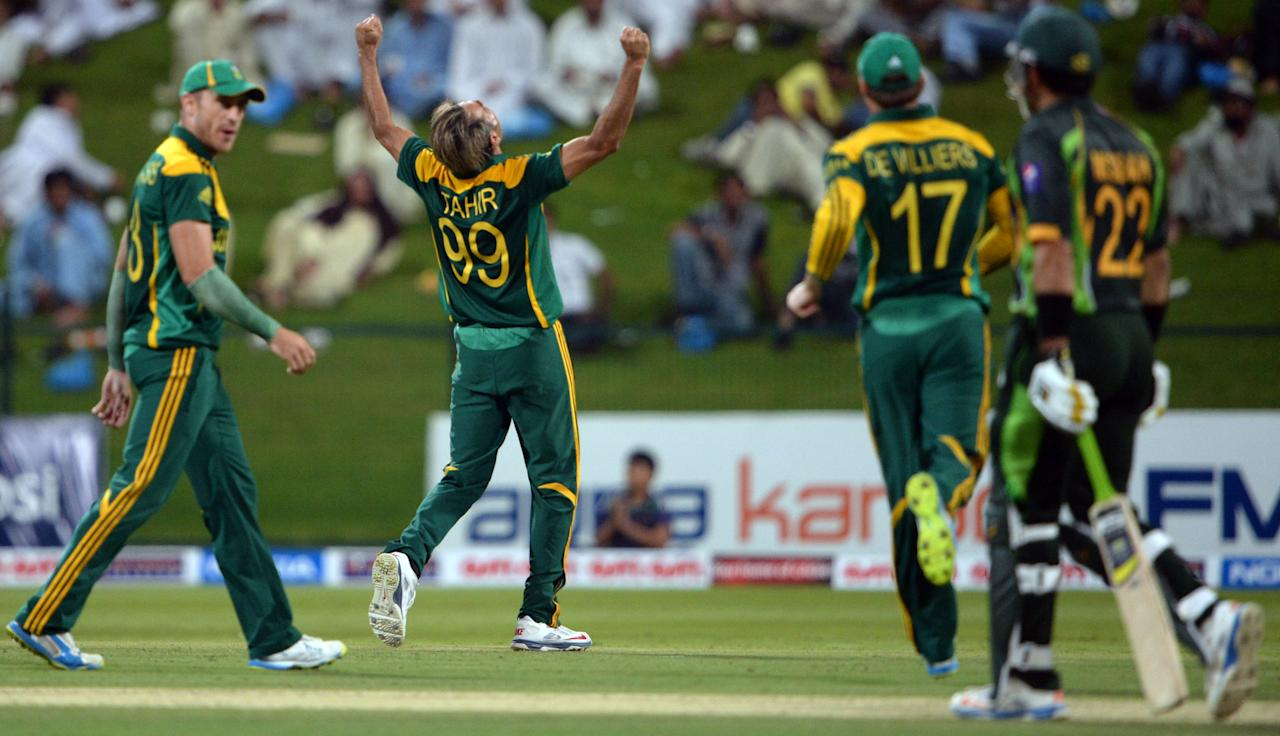 South African bowler Imran Tahir (2nd-L) celebrate after take wicket of Pakistan's captain Misbah-ul Haq (R) during the third day-night international in Sheikh Zayed Cricket Stadium in Abu Dhabi on Novemver 6, 2013. Pakistan were chasing 260 runs target after South Africa made 259 runs for eight wicket in their 50 overs. The five-match series is tied at 1-1. AFP PHOTO/ Asif HASSAN        (Photo credit should read ASIF HASSAN/AFP/Getty Images)
