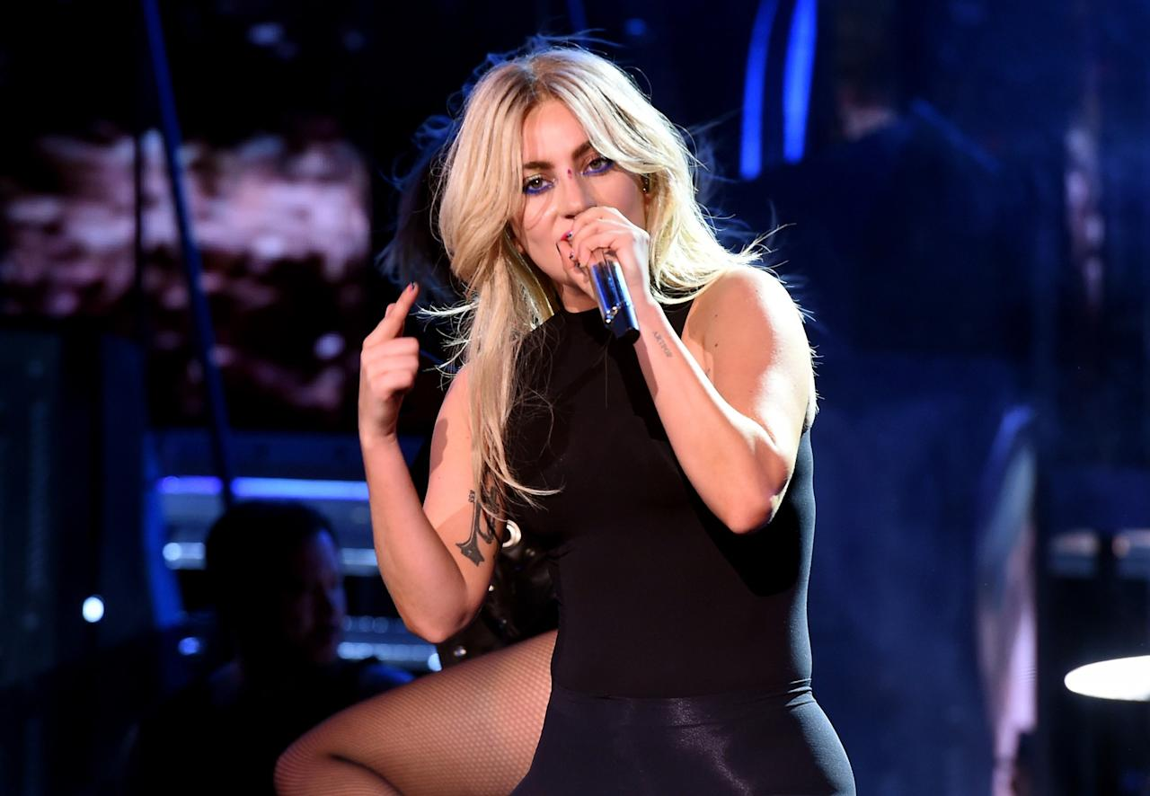 <p>Blond bombshell! Lady Gaga channeled Farrah Fawcett with this center-parted feathered hairstyle. </p>