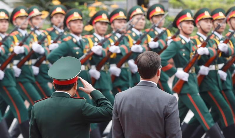 U.S. Defense Secretary Mark Esper and Vietnam's Defence Minister General Ngo Xuan Lich attend a welcoming ceremony in Hanoi