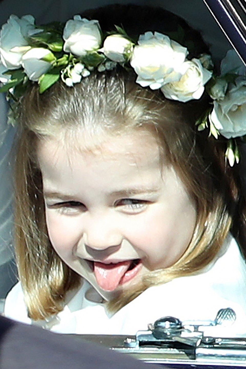 <p>Princess Charlotte channels her uncle Prince Harry's goofy side as she sticks out her tongue to royal wedding onlookers. </p>