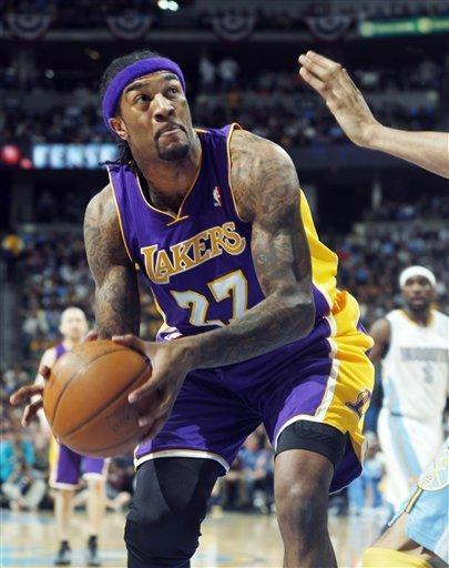 Los Angeles Lakers center Jordan Hill goes up for a shot against the Denver Nuggets in the first quarter of Game 4 of the teams' first-round NBA basketball series in Denver on Sunday, May 6, 2012. (AP Photo/David Zalubowski)