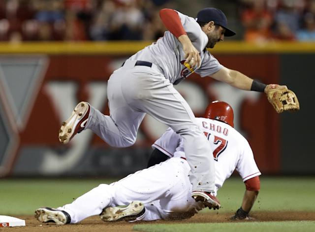 Cincinnati Reds' Shin-Soo Choo (17) slides hard into second base after being force, causing St. Louis Cardinals second baseman Matt Carpenter to hold on to the ball in the sixth inning of a baseball game, Tuesday, Sept. 3, 2013, in Cincinnati. Joey Votto was safe at first. (AP Photo/Al Behrman)