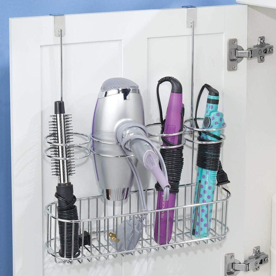 "<p>Keep your tools and cords tidy with this smart <a href=""https://www.popsugar.com/buy/mDesign-Metal-Over-Door-Organizer-551633?p_name=mDesign%20Metal%20Over%20Door%20Organizer&retailer=amazon.com&pid=551633&price=18&evar1=casa%3Aus&evar9=47251564&evar98=https%3A%2F%2Fwww.popsugar.com%2Fhome%2Fphoto-gallery%2F47251564%2Fimage%2F47252511%2FmDesign-Metal-Over-Door-Bathroom-Styling-Tool-Organizer&list1=cleaning%2Corganization%2Cspring%20cleaning%2Csmall%20space%20living%2Cbathrooms%2Chome%20organization&prop13=mobile&pdata=1"" class=""link rapid-noclick-resp"" rel=""nofollow noopener"" target=""_blank"" data-ylk=""slk:mDesign Metal Over Door Organizer"">mDesign Metal Over Door Organizer</a> ($18).</p>"