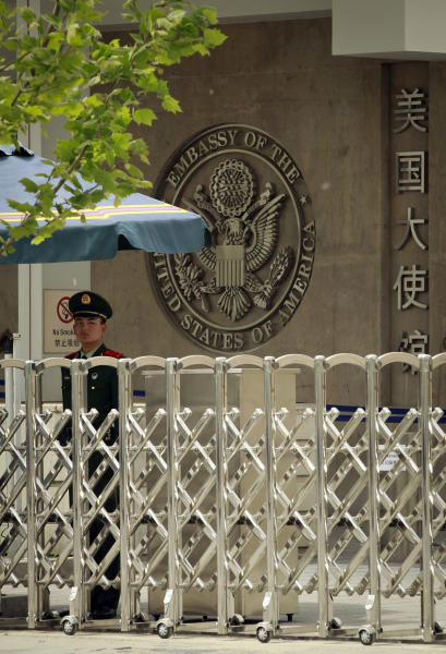 Chinese paramilitary police officer stands guard at the entrance of the U.S. Embassy in Beijing, China, Sunday, April 29, 2012. Chen Guangcheng, a blind legal activist who escaped house arrest in his Chinese village is under the protection of American officials, activists said Saturday, creating a diplomatic dilemma for the U.S. and China days ahead of a visit by Secretary of State Hillary Rodham Clinton. (AP Photo/ Vincent Thian)