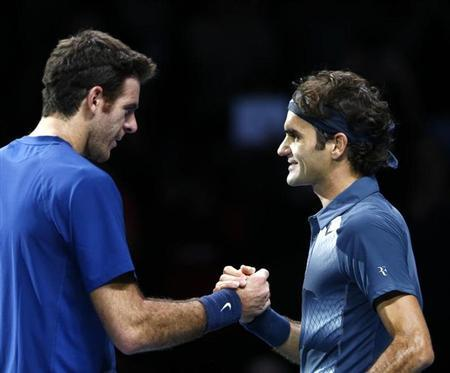 Federer of Switzerland shakes hands with Del Potro of Argentina after winning his men's singles tennis match at the ATP World Tour Finals in London