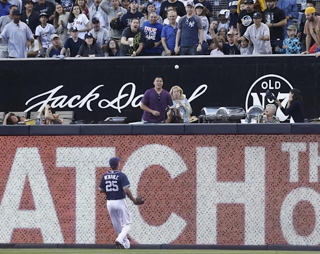 San Diego Padres right fielder Will Venable runs out of room as the home run hit by New York Yankees' Curtis Granderson lands in the stands in the seventh inning of an interleague baseball game in San Diego, Saturday, Aug. 3, 2013. (AP Photo/Lenny Ignelzi)
