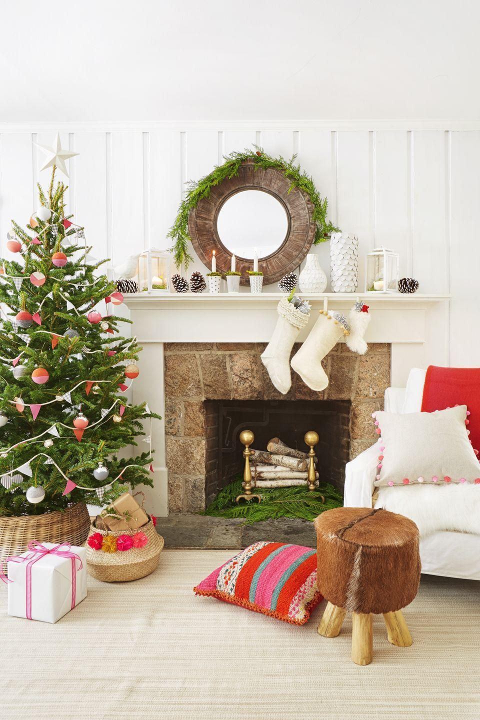 """<p>Pops of pink on <a href=""""https://www.goodhousekeeping.com/holidays/christmas-ideas/g393/homemade-christmas-ornaments/"""" rel=""""nofollow noopener"""" target=""""_blank"""" data-ylk=""""slk:DIY ornaments"""" class=""""link rapid-noclick-resp"""">DIY ornaments</a> and a pennant-style garland make this spruce extra merry. </p>"""