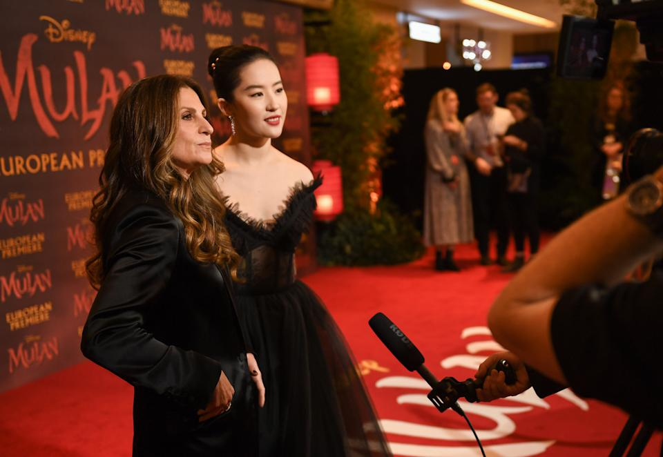 """LONDON, ENGLAND - MARCH 12:  Niki Caro (L) and Yifei Liu attend the European Premiere of Disney's """"MULAN"""" at Odeon Luxe Leicester Square on March 12, 2020 in London, England. (Photo by Ian Gavan/Getty Images for Disney)"""