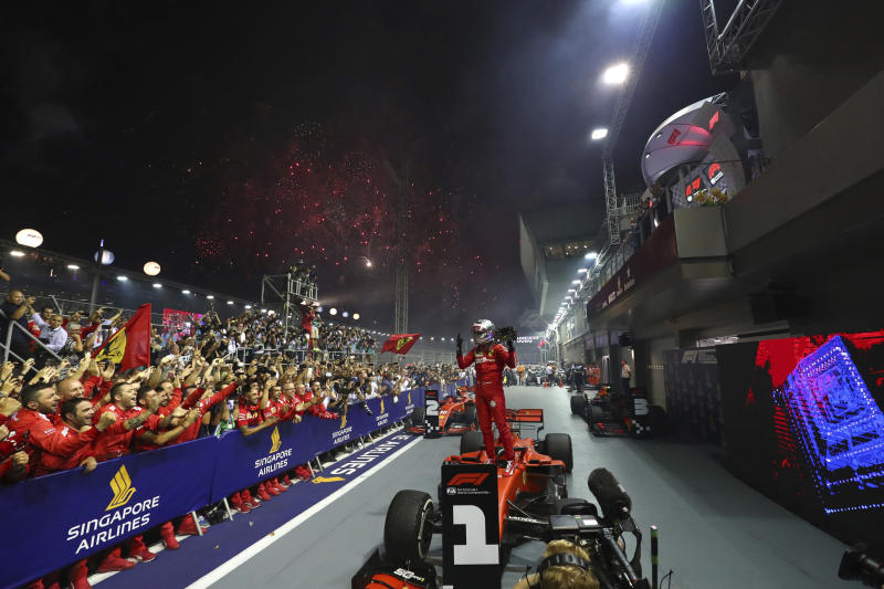 In this Sunday, Sept. 22, 2019, file photo, Ferrari driver Sebastian Vettel of Germany celebrates after winning the Singapore Formula One Grand Prix in Singapore. (AP Photo/Lim Yong Teck, File)