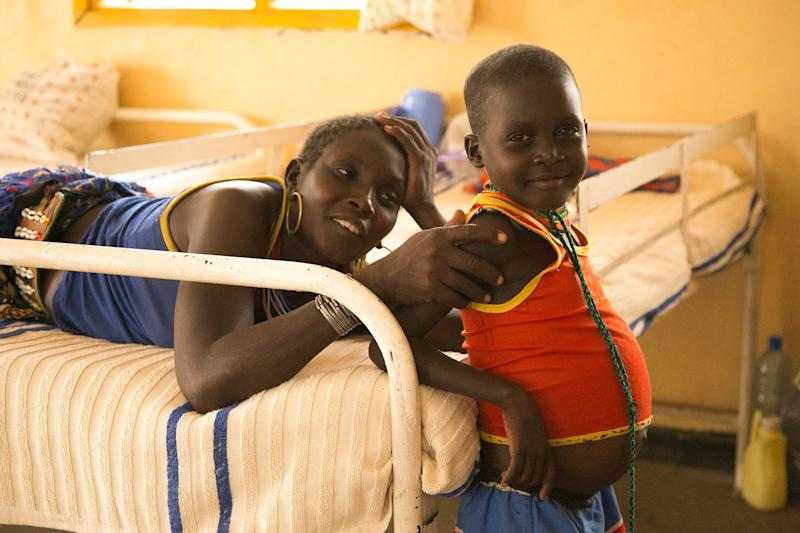 A mother sits with her child, who is being treated for kala azar in the specialty ward at Kacheliba Hospital in western Kenya. (Zoe Flood)