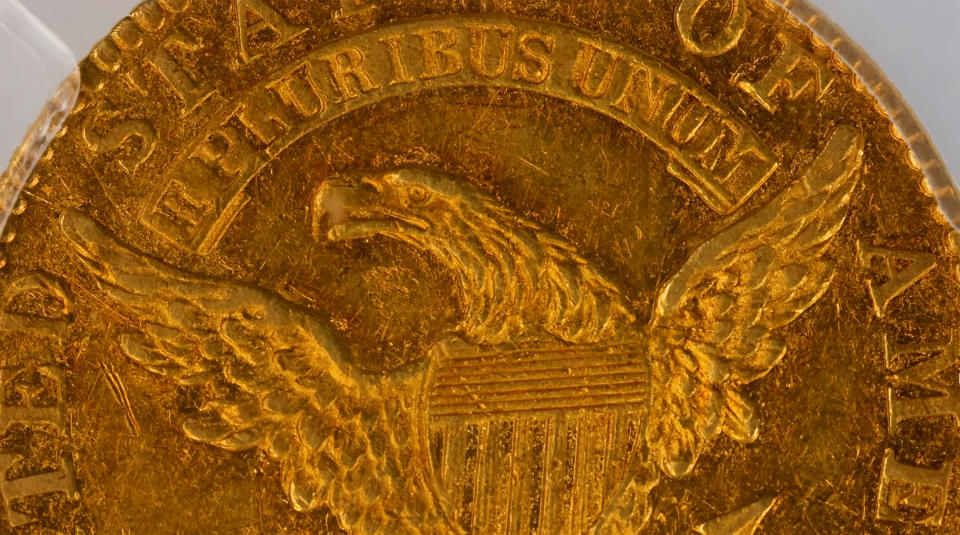 This image taken from video provided by Stack's Bowers Galleries shows the back of a 1822 Half Eagle $5 piece gold coin from the D. Brent Pogue Collection that was sold at Stack's Bowers Galleries in Las Vegas. The coin trading world has a new gold standard, after the only known 1822 half eagle $5 piece in private hands sold at auction in Las Vegas for $8.4 million, experts said Friday, March 26, 2021. (Stack's Bowers Galleries via AP)