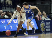 Mississippi State guard Roshunda Johnson (11) steals the ball from Kentucky guard Maci Morris (4) in the second half of an NCAA college basketball game at the women's Southeastern Conference tournament Friday, March 2, 2018, in Nashville, Tenn. Mississippi State won 81-58. (AP Photo/Mark Humphrey)