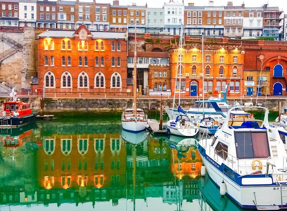 <p>In this vibrant image, boats rest on Ramsgate harbour in Kent with a backdrop of the Sailors Church, Harbour Mission and the Smack Boys Home. (Brian Whitehead)</p>