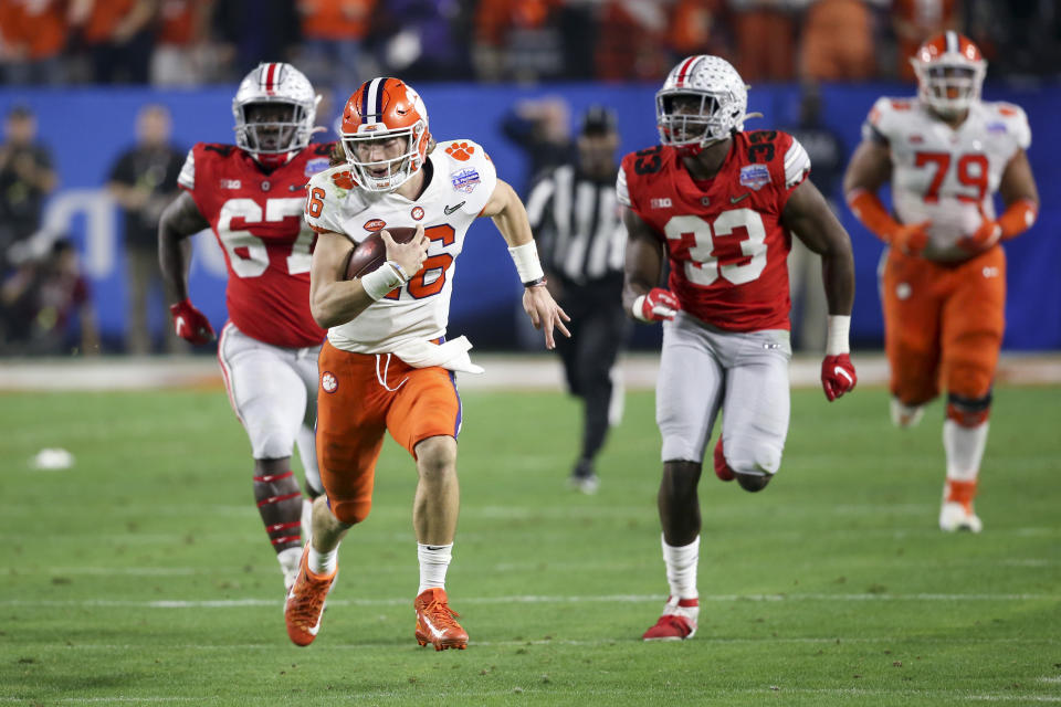 Clemson quarterback Trevor Lawrence runs for a touchdown against Ohio State during the first half of the Fiesta Bowl NCAA college football playoff semifinal Saturday, Dec. 28, 2019, in Glendale, Ariz. (AP Photo/Ross D. Franklin)