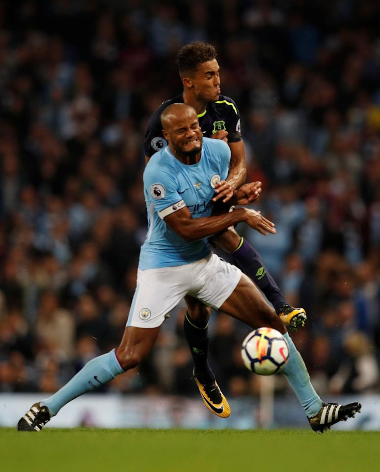 "Soccer Football - Premier League - Manchester City vs Everton - Manchester, Britain - August 21, 2017   Manchester City's Vincent Kompany fouls Everton's Dominic Calvert-Lewin    REUTERS/Phil Noble    EDITORIAL USE ONLY. No use with unauthorized audio, video, data, fixture lists, club/league logos or ""live"" services. Online in-match use limited to 45 images, no video emulation. No use in betting, games or single club/league/player publications. Please contact your account representative for further details.     TPX IMAGES OF THE DAY"