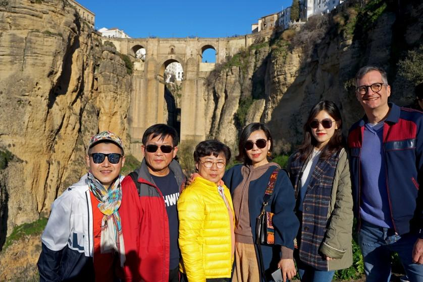 Charlie Gu, lar left, and his husband, Thomas Alfieri, far right, pose with Gu's parents and cousin on vacation in Ronda, Spain. Gu, who lives in San Francisco, uses WeChat to keep in touch with his family abroad and organize vacations. (Courtesy of Charlie Gu)