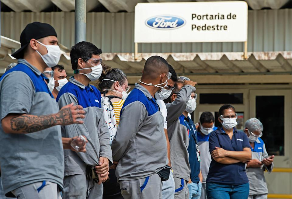 Workers of US automaker Ford attend a protest in front of the Ford manufacturing plant in Taubate, Sao Paulo state, Brazil on January 12, 2021. - Carmaker Ford said Monday losses exacerbated by the coronavirus epidemic would see it close its three factories in Brazil, where it has operated for a century, terminating some 5,000 jobs. (Photo by Claudio CAPUCHO / AFP) (Photo by CLAUDIO CAPUCHO/AFP via Getty Images)