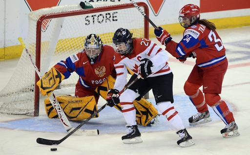 FILE - In this April 8, 2013, file photo, Canada's Hayley Wickenheiser, center, attempts to score on Russia's Anna Prugova as Svetlana Tkachyova defends during the first period of their semifinal game in the women's world hockey championship in Ottawa, Ontario. Since women's ice hockey became an Olympic sport in Nagano in 1998, the Canada and the United States have dominated the podium, winning every gold medal and all but one of the silvers. (AP Photo/The Canadian Press, Sean Kilpatrick, File)