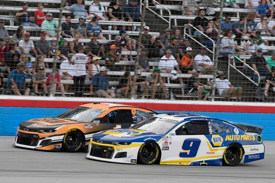 Kurt Busch, left, and Chase Elliott (9) head down the front stretch during the NASCAR Cup Series All-Star auto race at Texas Motor Speedway in Fort Worth, Texas, Sunday, June 13, 2021. (AP Photo/Larry Papke)