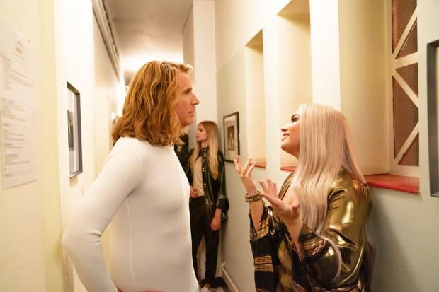 Ferrell, in his Lars outfit, chats with Demi Lovato, who plays Katiana.