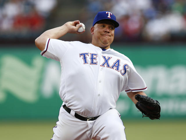 Texas Rangers starting pitcher Bartolo Colon delivers to a Cleveland Indians batter during the first inning of a baseball game, Saturday, July 21, 2018, in Arlington, Texas. (AP Photo/Jim Cowsert)