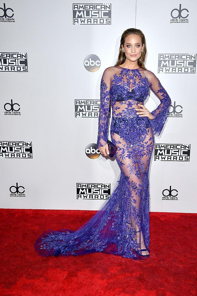 <p>Hannah Davis carried on the naked dress trend championed by Jennifer Lopez by wearing a purple lace version on the red carpet. <em>(Photo: Getty Images)</em> </p>